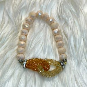 Cream stretch beaded bracelet. GUC clear/amber.